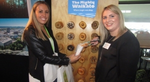 'Have a donught,' says Katrina Soepnel (right), Hamilton & Waikato Tourism to Brianna Kerridge, ID New Zealand