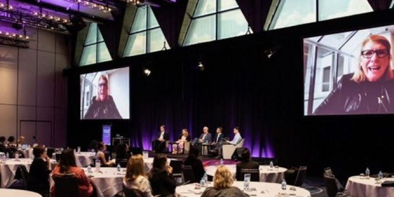 Paula Leishman on the big screen during a panel discussion at the PCOA conference 2020