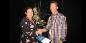 Ally Eastaugh, manager of Convene South; hands the stand of the year certificate to Theme Productions owner Chris Stead