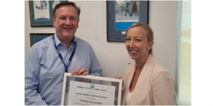 Cindy Axisa, PCOA presenting Trevor with the award at the Centium offices.